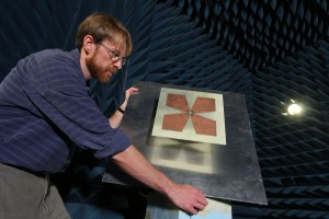 Prof. Keith Vanderlinde tests a feed in the Physics department's anechoic chamber.