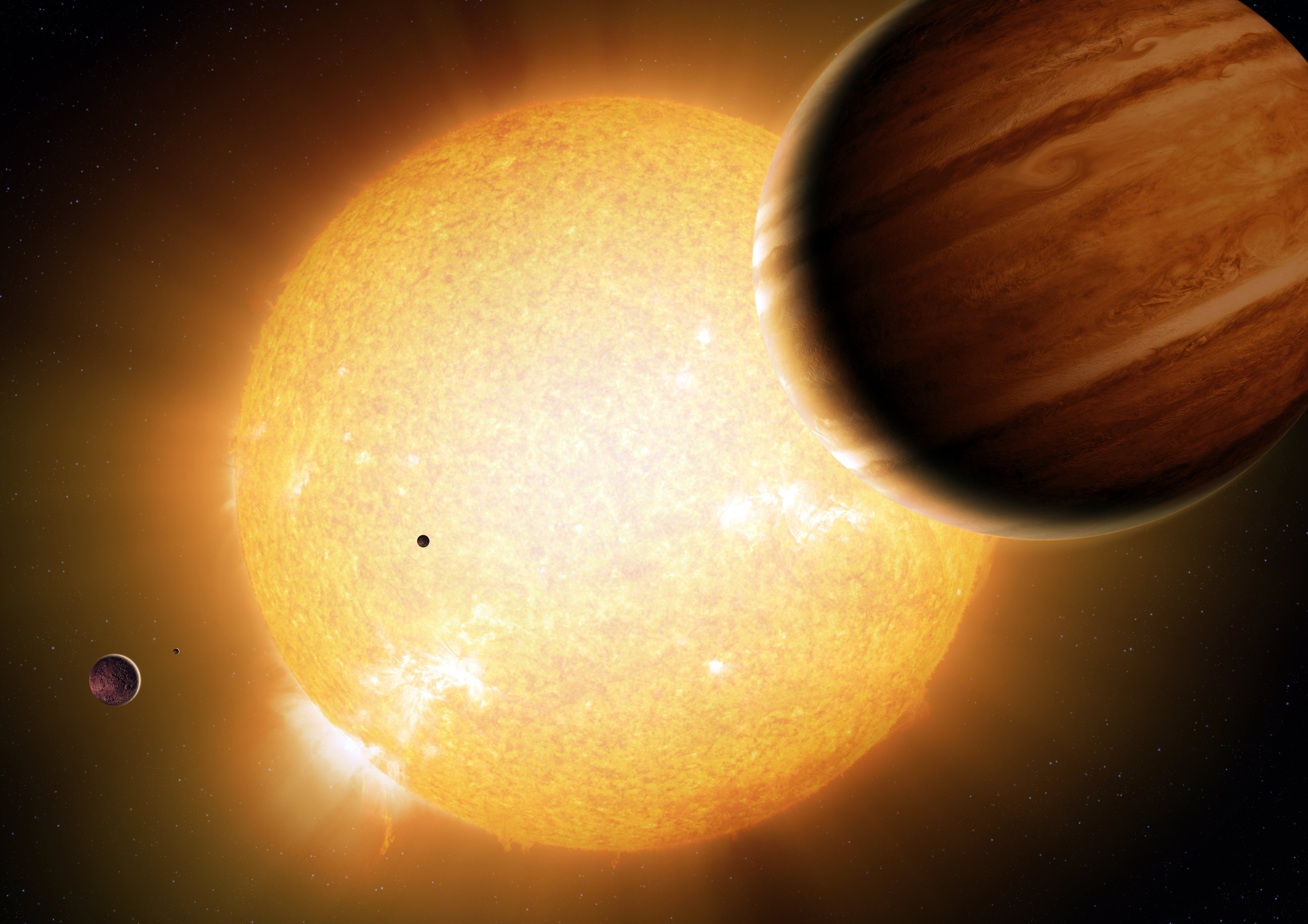An artist's portrayal of a Warm Jupiter gas-giant planet (r.) in orbit around its parent star, along with smaller companion planets. Image credit: Detlev Van Ravenswaay/Science Photo Library