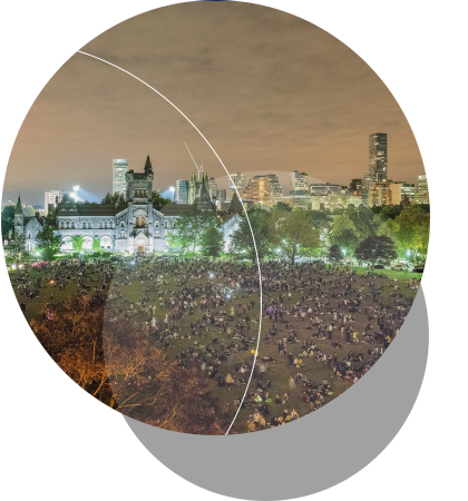"Thousands pack U of T's King's College Circle at the Dunlap's Supermoon Total Lunar Eclipse Viewing Party. Clouds diminish the visibility of the eclipse, but not the crowd's enthusiasm. <br />  <br /><span style=""font-size:75%;""><em>Credit:  Lorne  Bridgman</em></span>"